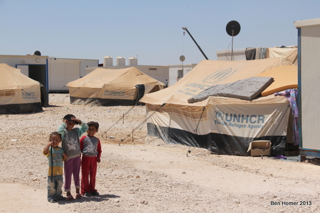 Kids outside tents in Za'atari. An estimated 40% of Za'atari residents are under the age of 16. Nearly every tent and caravan has electricity and Satellite dish.