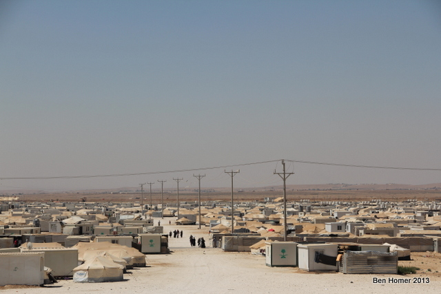 A wide shot of the camp. The rapid growth of the camp has led to many distinct neighborhoods in the camp some of which are hostile to the NGOs. The UN leadership in the camp recently began a program to work with leaders in each area to try to improve cooperation between aid workers and residents.