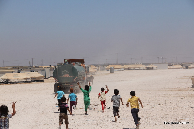 Children chase after a water truck. More than a million litres of water are delivered to the camp per day by trucks which are constantly in motion throughout the camp. While the UN and other NGOs have begun to build capacity for schooling, there is little for kids in the camp to do.